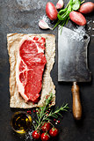 vintage cleaver and raw beef steak