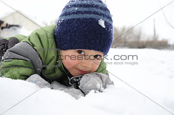 Boy portrait surrounded snow