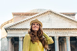 Portrait of happy young woman pantheon and attractions in rome,