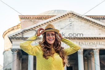 Portrait of happy young woman in front of pantheon in rome, ital