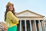 Portrait of smiling young woman in front of pantheon in rome, it