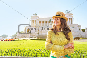 Portrait of happy young woman looking into distance on piazza ve