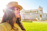 Profile portrait of happy young woman on piazza venezia in rome,