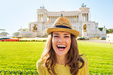 Portrait of smiling young woman on piazza venezia in rome, italy