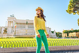 Happy young woman walking on piazza venezia in rome, italy
