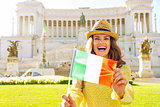 Portrait of happy young woman showing italian flag on piazza ven