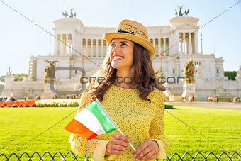 Portrait of happy young woman with italian flag on piazza venezi