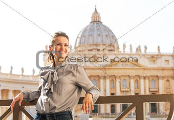 Portrait of happy young woman in front of basilica di san pietro