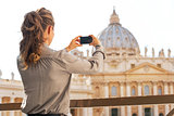 Young woman taking photo of basilica di san pietro in vatican ci