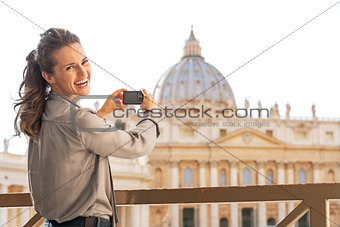 Portrait of happy young woman taking photo of basilica di san pi