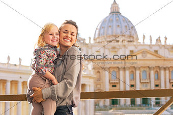 Portrait of happy mother and baby girl hugging on piazza san pie