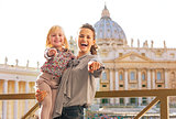 Happy mother and baby girl on piazza san pietro in vatican city