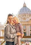 Portrait of happy mother and baby girl on piazza san pietro in v