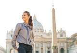 Happy young woman sightseeing on piazza san pietro in vatican ci