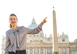 Happy young woman on piazza san pietro in vatican city state poi