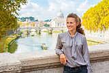 Portrait of happy young woman on bridge with view on basilica di
