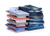 stack Jeans and dress shirts on white background