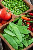 Fresh green peas, tomato and chili