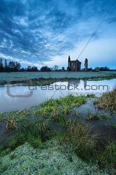 Beautiful sunrise landscape of Priory ruins in countryside locat