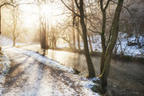 Beautiful Winter snow covered countryside landscape of river flo