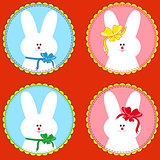 Four funny rabbits in round frameworks