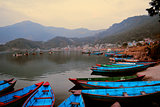 Boats Beached Outside Mountain Town