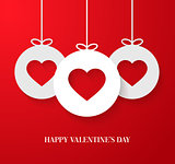 Valentines day card with hanging hearts.