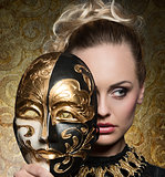 close-up of girl with baroque mask