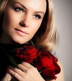 Stylish woman holding roses flower