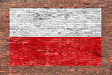 Flag of Poland painted on brick wall