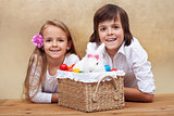 Happy kids with easter bunny and colorful eggs