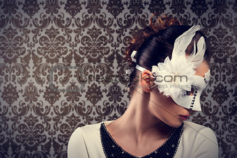 carnival girl with white mask