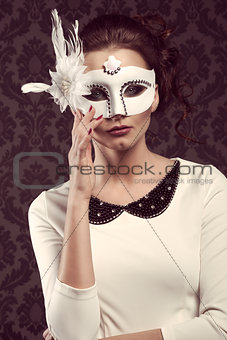 old fashion style woman in white carnival mask