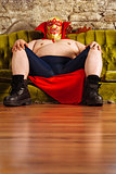 Luchador sitting on a couch