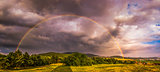 Rainbow over Landscape at Sunset