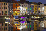 Embankment of the river Leie in Ghent town at night, Belgium