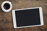 Tablet pc on table desk with coffee cup