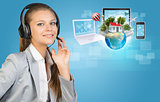 Businesswoman in headset, Globe, computers, smartphone and network beside