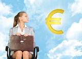 Businesswoman sitting on office chair, looking up at euro sign in the air