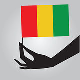 Hand with flag Guinea
