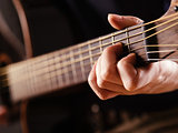 playing acoustic guitar closeup