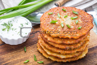 Potato pancakes on a wooden board