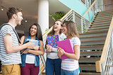 Smiling students chatting together outside