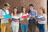 Happy students standing and reading