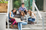 Students sitting on steps studying