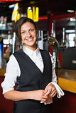 Happy barmaid smiling at camera