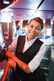 Pretty barmaid smiling at camera