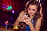 Pretty girl looking at smartphone