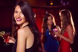 Pretty brunette having a cocktail