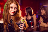 Pretty redhead drinking a cocktail